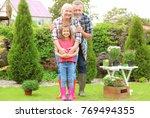 elderly couple with... | Shutterstock . vector #769494355