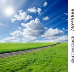 rural road in green field - stock photo