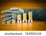 coins stack on top of word tax... | Shutterstock . vector #769505134