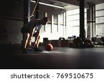 man training with heavy...   Shutterstock . vector #769510675