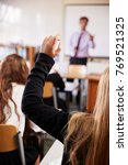 female student raising hand to... | Shutterstock . vector #769521325