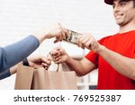 the woman received the parcel... | Shutterstock . vector #769525387