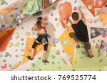 young couple exercising in...   Shutterstock . vector #769525774