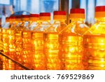 oil in bottles. industrial... | Shutterstock . vector #769529869