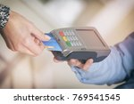 paying with credit or debit... | Shutterstock . vector #769541545