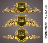 set of golden royal shields... | Shutterstock .eps vector #769565251