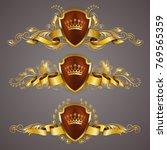 set of golden royal shields...   Shutterstock .eps vector #769565359