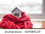 house in winter   heating... | Shutterstock . vector #769589119