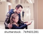 smiling father and daughter... | Shutterstock . vector #769601281