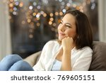 candid woman dreaming sitting... | Shutterstock . vector #769605151