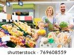cheerful european family... | Shutterstock . vector #769608559