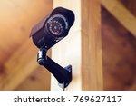 black security surveillance camera - stock photo