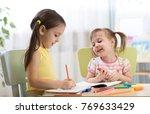 kids drawing in kindergarten.... | Shutterstock . vector #769633429