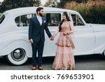 handsome indian groom dressed... | Shutterstock . vector #769653901