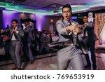 handsome indian groomsmen look... | Shutterstock . vector #769653919