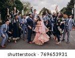 handsome indian groom dressed... | Shutterstock . vector #769653931
