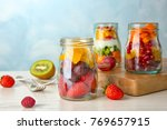 glassware with delicious fruit... | Shutterstock . vector #769657915