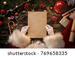 close up of santa claus hands... | Shutterstock . vector #769658335