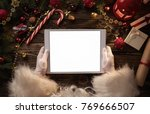 close up of santa claus hands... | Shutterstock . vector #769666507