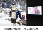 Small photo of Intelligent Digital Signage , Augmented reality marketing and face recognition concept. Interactive artificial intelligence digital advertisement in fashion retail shopping Mall.