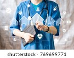 doctor pushing button house... | Shutterstock . vector #769699771