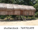 Small photo of Pahang, Malaysia - 10 Dec : An aboriginal village in Lanchang. Orang asli or aborigine way of living has become popular attraction to tourists in Malaysia