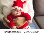 baby sleeping with christmas...   Shutterstock . vector #769738234