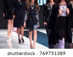female models walk the runway... | Shutterstock . vector #769751389