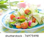 Fresh salad from raw vegetables and lettuce - stock photo