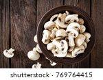 fresh mushrooms on wooden table ...   Shutterstock . vector #769764415