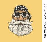 bearded biker in motorcycle... | Shutterstock .eps vector #769769377