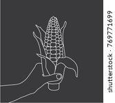 hand holding a corn  vector... | Shutterstock .eps vector #769771699