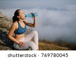 woman in sport pants holding a... | Shutterstock . vector #769780045