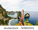 a man with a backpack climbed a ... | Shutterstock . vector #769803541