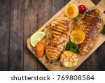 grilled chicken breast on the... | Shutterstock . vector #769808584