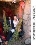 Small photo of SANAA, MARCH 14: Two unidentified dealers of Khat (Catha Edulis) shown on March 14, 2010 in Sanaa, Yemen. Khat contains an amphetamine alkaloid stimulant narcotic illegal in most countries.