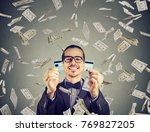 happy debt free man holding a... | Shutterstock . vector #769827205