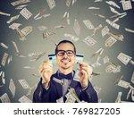 happy debt free man holding a... | Shutterstock . vector #769827205