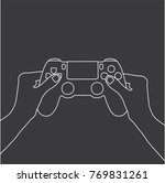 hand holding a console... | Shutterstock .eps vector #769831261