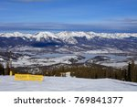 A view of Silverthorne, Colorado and Rocky Mountains from the top of Keystone Ski Resort in winter - stock photo