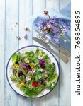 Small photo of salad plate with flowers