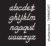 glowing white neon script font... | Shutterstock .eps vector #769869247
