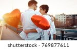 couple hugging and kissing... | Shutterstock . vector #769877611