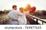 couple in love cuddling while... | Shutterstock . vector #769877635