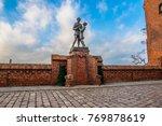 Small photo of GRUDZIADZ, POLAND - DECEMBER 3, 2017: Monument to uhlan with girlfriend. Grudziadz, Poland