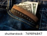 leather wallet with us bucks in ... | Shutterstock . vector #769896847