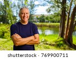 handsome middle age man outdoor ... | Shutterstock . vector #769900711