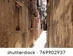 view of a narrow street with... | Shutterstock . vector #769902937