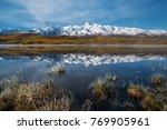 snowy mountain peaks... | Shutterstock . vector #769905961