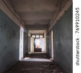 Small photo of Dark creepy corridor with many doors in abandoned ruined hospital, horror hallway or tunnel, toned